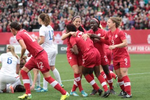 Canada celebrates Kadeisha Buchanan's goal against the USWNT in May. (©CanadaSoccer / by Douglas Portz)