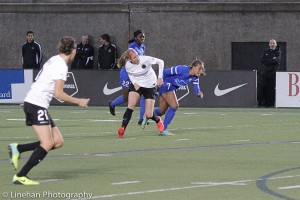 Nikki Marshall (center) has been diagnosed with a torn right ACL. (Photo Copyright Clark Linehan for The Equalizer)