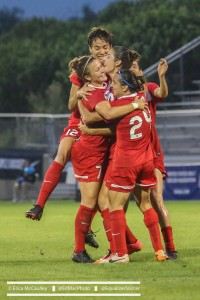 The Spirit celebrate Averbuch's dramatic game-winning goal. (Photo Copyright Erica McCaulley for The Equalizer)