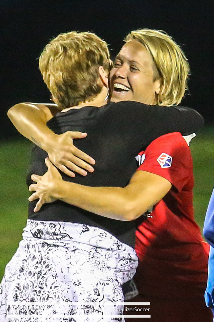 Lori Lindsey, hugging NWSL Executive Director Cheryl Bailey, played her last match at the Maryland SoccerPlex last week.  (Photo Copyright Erica McCaulley for The Equalizer)