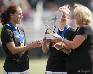 Lauren Holiday and Becky Sauerbrunn receive the NWSL Championship trophy from league executive director Cheryl Bailey. Holiday and Sauerbrunn are FC Kansas City's leaders. (Photo Copyright Patricia Giobetti for The Equalizer)