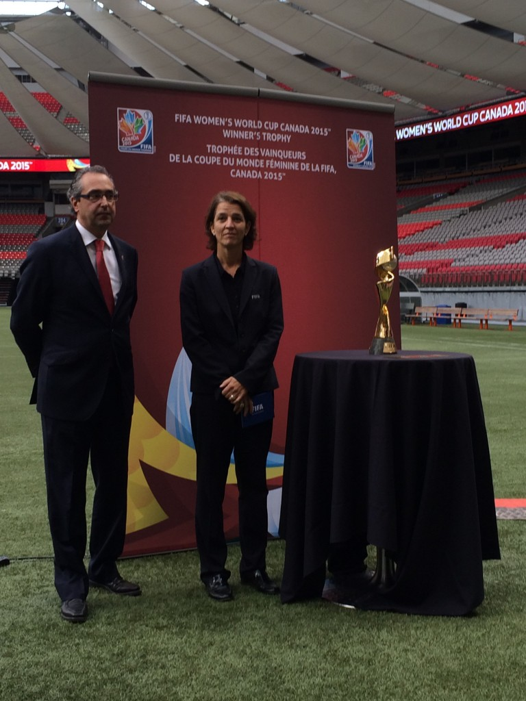 Peter Montopoli and Tatjana Haenni with the World Cup trophy at BC Place in Vancouver, site of the 2015 World Cup final. (Photo Copyright Harjeet Johal for The Equalizer)