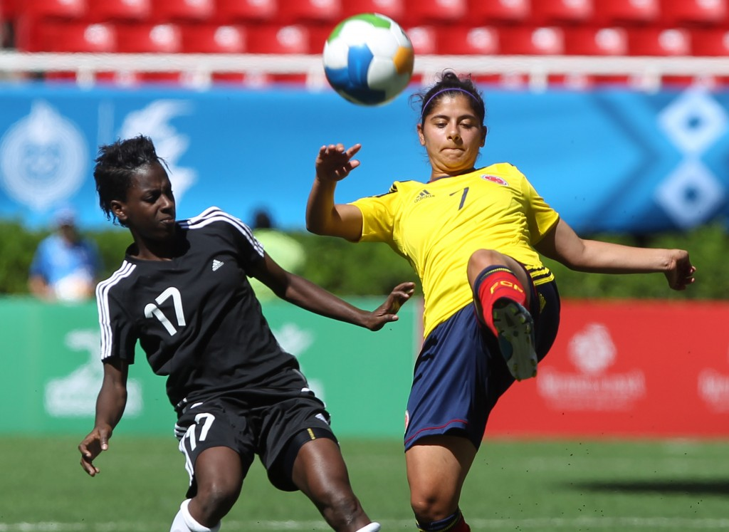 Kennya Cordner (left) and her Trinidad & Tobago teammates hardly have anything, but this month they have a chance to become the first Caribbean team to qualify for the Women's World Cup. (AP Photo)