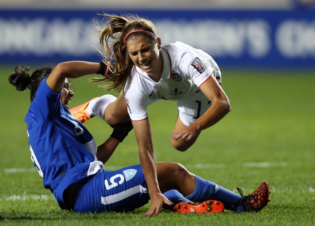 Alex Morgan injured her left ankle on Friday against Guatemala. It's the same ankle that recently kept her sidelined for seven months. (USA Today Images)
