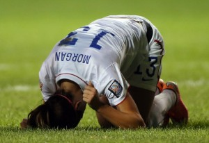 Alex Morgan pounds the ground after going down injured against Guatemala. (USA Today Images)