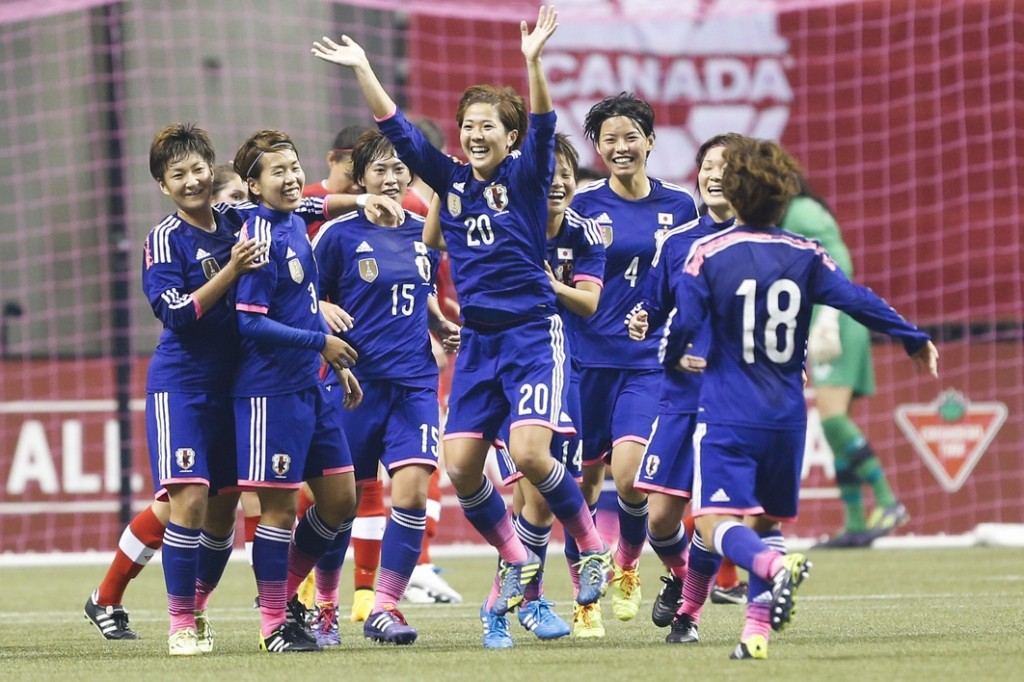 Japan midfielder Asano Nagasato (20) celebrates her goal against Canada during the first half at BC Place. (Joe Nicholson-USA TODAY Sports)
