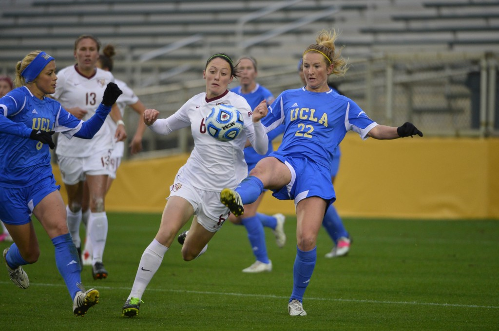 UCLA's Sam Mewis (right) and FSU's Megan Campbell (left) are players to watch in the 2014 NCAA tournament. (USA Today Images)