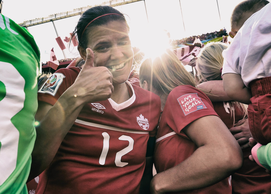 Christine Sinclair celebrates Canada's opening-day win. (Getty Images)