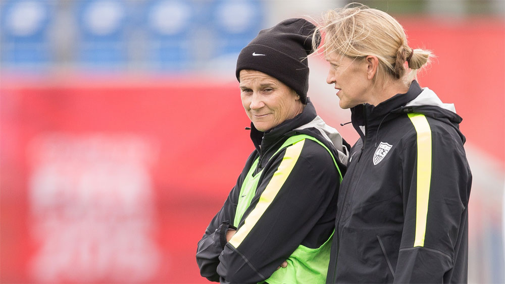 Dawn Scott, right, talks to U.S. coach Jill Ellis. Scott plays an important, even if behind-the-scenes role with the U.S. women's national team. (Getty Images)