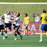 Anja Mittag celebrates after scoring against Sweden in Saturday's 4-1 win.  (Getty Images)