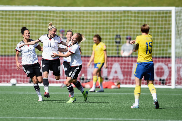 Anja Mittag celebrates after scoring against Sweden in  4-1 win in 2015 World Cup Round of 16.  (Getty Images)