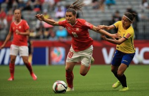 Ramona Bachmann (left) battled with Angie Ponce during Switzerland's 10-1 blowout of Ecuador.  (Getty Images)
