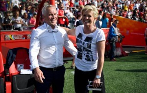 Coaches Even Pellerud (left, Norway) and Sylvia Nied were all smiles after a 1-1 draw Thursday in Ottawa.  (Getty Images)