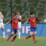 Ecstasy and agony -- Korea Republic players celebrate while Spain react to their elimination (Getty Images)