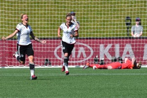 Anja Mittag (11) celebrates her goal against Sweden.  It was Mittag's 5th of the World Cup. (Getty Images)