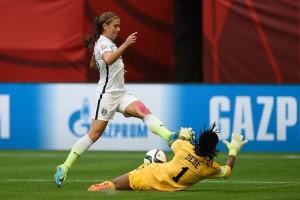 Alex Morgan getting denied by Nigeria keeper Precious Dede. (Getty Images)