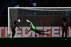 Erin Naylor guessed right but could not get to Wang Lisi's penalty.  (Getty Images)