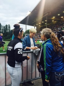 United States and Seattle Reign FC midfielder Megan Rapinoe signs autographs for fans. (Photo Copyright Patricia Giobetti for The Equalizer)