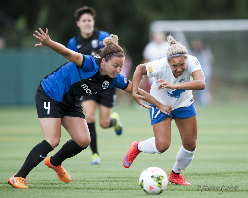 Rachel Corsie (left) has quickly settled into a competitive Seattle Reign FC lineup. (Photo Copyright Patricia Giobetti for The Equalizer)