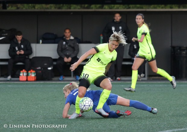 Jess Fishlock about to be inadvertenly rolled over by McCall Zerboni (photo copyright Linehan Photography for THhe Equalizer)