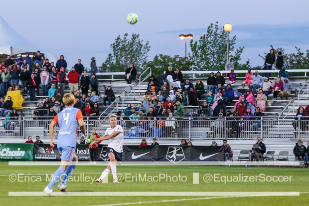 Goalscorer Joanna Lohman watches a ball as it sails over the head of Rebecca Moros. (photo copyright EriMac Photo for The Equalizer)