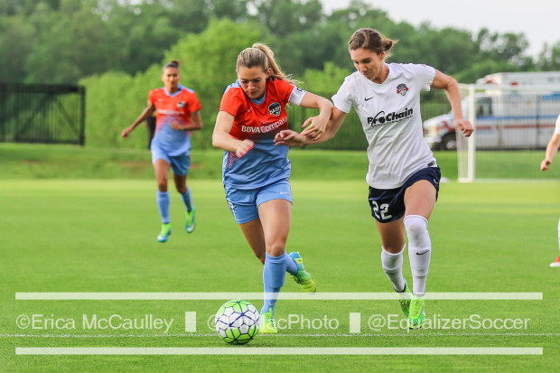 Kealia Ohai, center, will be a key figure for the Dash on Thursday and the rest of the season. Here she battle with the Spirit's Alyssa Kleiner. (photo copyright EriMac Photo for The Equalizer)