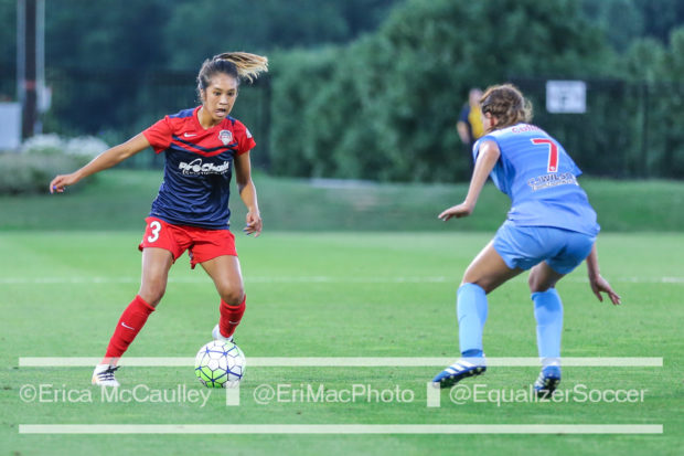 Caprice Dydasco looks for a way around Taylor Comeau during Spirit's 2-0 win over the Red Stars in July. (photo copyright EriMac Photo for The Equalizer)