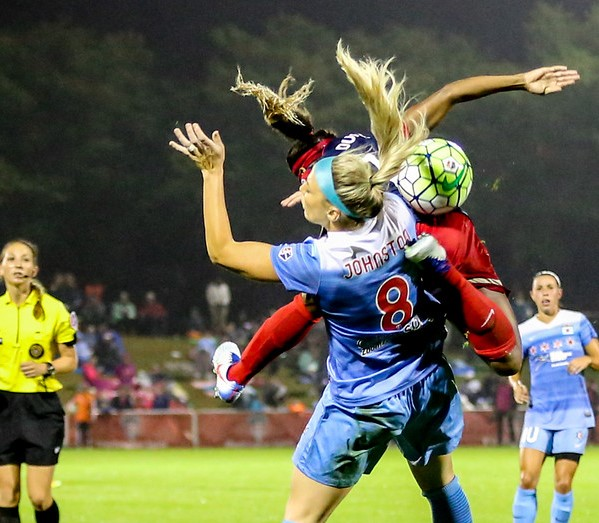 That's Crystal Dunn on the other side of Julie Johnston during one of their many encounters during Friday night's epic semifinal (photo copyright EriMac Photo for The Equalizer)