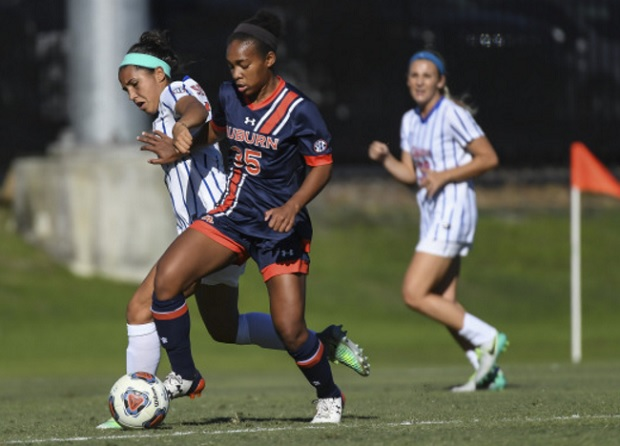 Kristen Dodson fights for control of the ball in Auburn's 3-1 NCAA tournament third round win over Florida (photo courtesy of Auburn University)