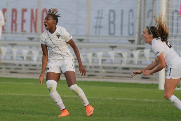 Kadeisha Buchanan celebrates during WVU's Big 12 Conference Championship win (photo courtesy Mountaineer Maniacs Twitter)