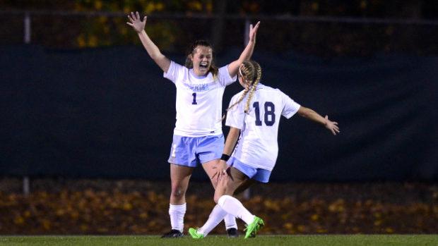 Madison Schultz celebrates her game-winning goal with teammate Megan Buckingham (photo courtesy of Jeffrey A. Camarati and UNC)