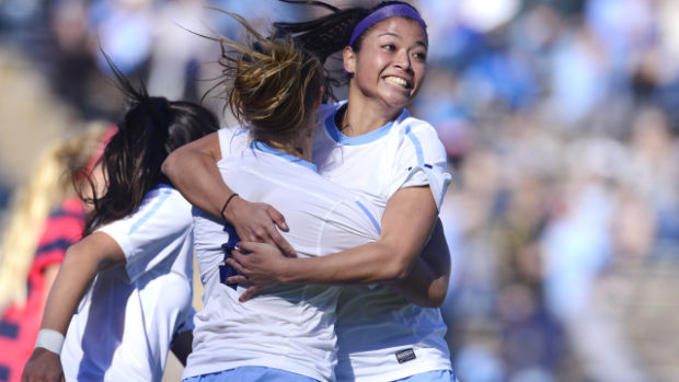 UNC celebrates their first round win over LIberty. (photo courtesy of Jeffrey A. Camarati and UNC)