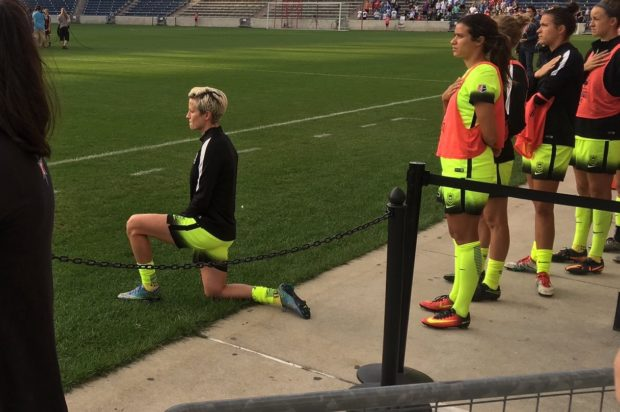Megan Rapinoe kneeling during the National Anthem of Reign's September 4 match in Chicago. (photo courtesy @gbpackfan32