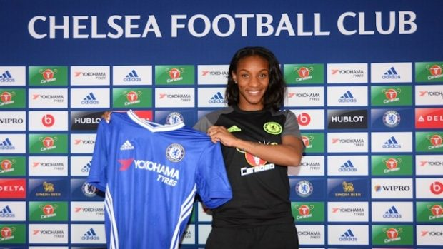 Crystal Dunn holds her new Chelsea Ladies shirt. The 2015 NWSL Most Valuable Player is heading to England. (photo: Chelsea Ladies)