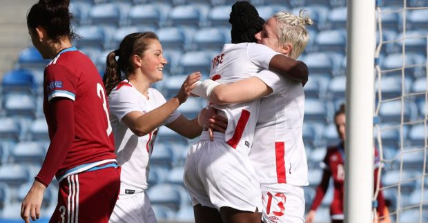 Sophie Schmidt, 13, is greeted by birthday girl Deanne Rose after scoring against Russia (photo: Canada Soccer Association)