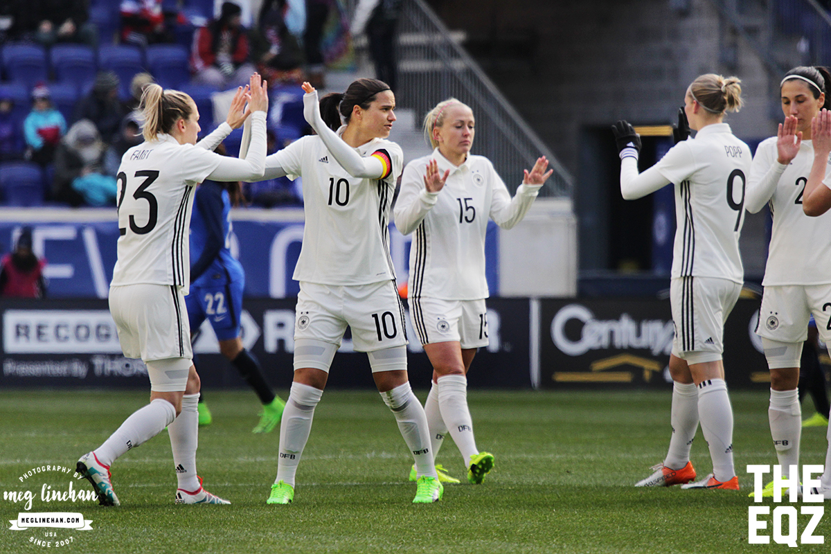 Germany captain Dzsenifer Marozsan dispenses high-fives for the start of the second half against France. (MEG LINEHAN/Equalizer Soccer)