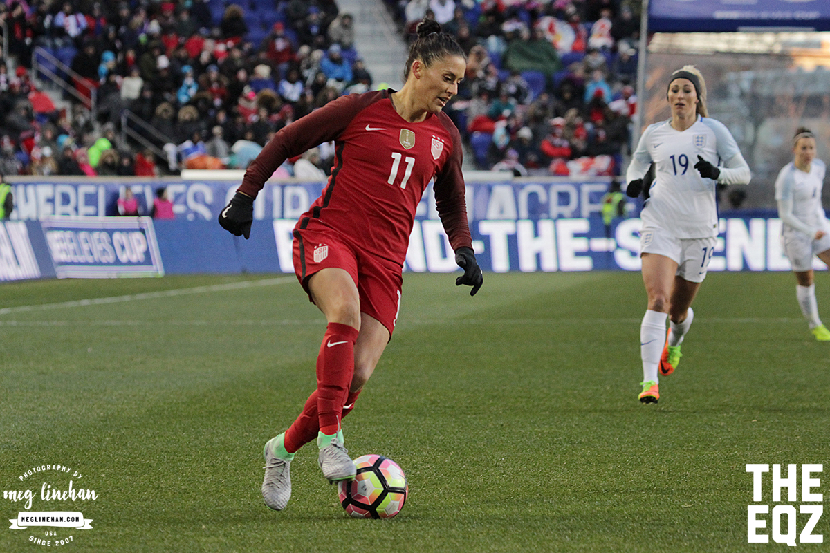Ali Krieger makes the turn as England's Toni Duggan rushes in to pressure. (MEG LINEHAN/Equalizer Soccer)