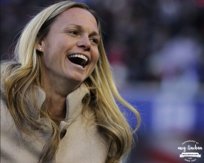Christie Pearce enjoying the brief ceremony honoring her remarkable career with the USWNT (photo copyright Meg Linehan for The Equalizer)