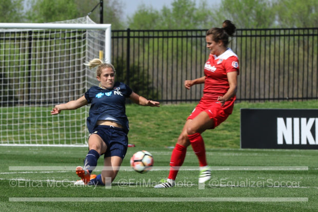 Abby Dahlkemper slides to challenge Katie Stengel during the Courage's 1-0 win over the Washington Spirit (photo copyright: EriMac Photo for The Equalizer)