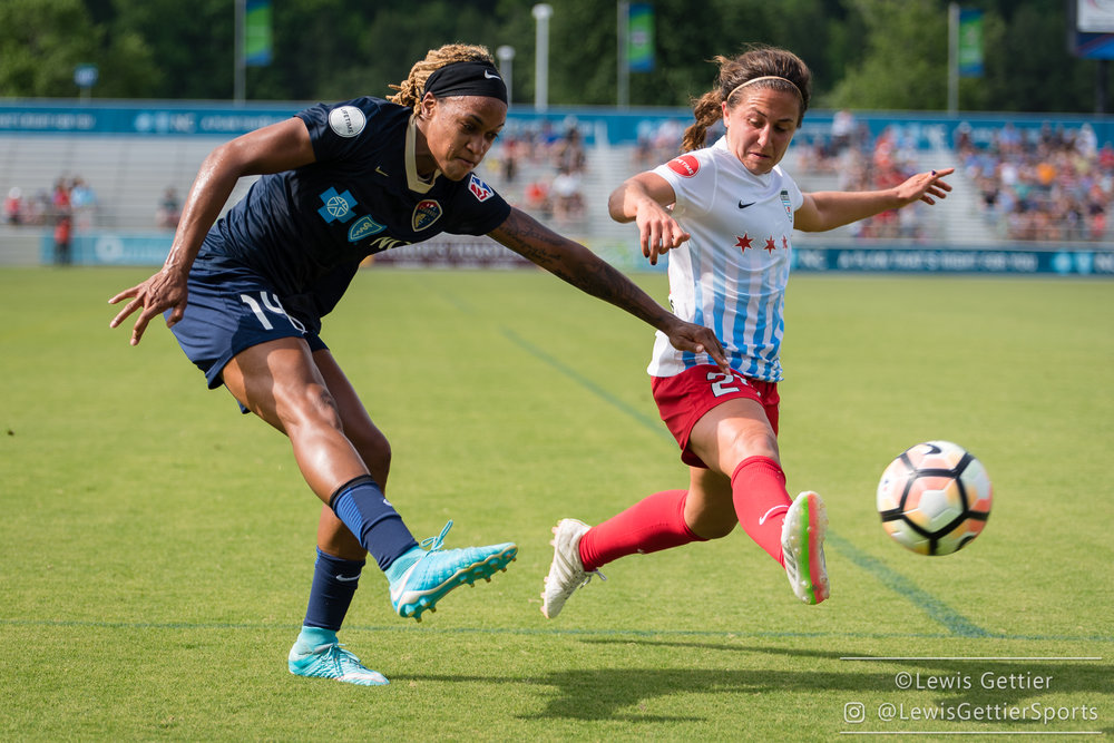 Danielle Colaprico, here battling Jessica McDonald, has a new role on the Red Stars this season. (photo copyright Lewis Gettier)