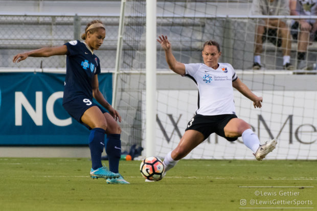 Christie Pearce tries to block a ball from Lynn Williams during a match between the NC Courage and Sky Blue FC in Cary, NC in Week 7 of the 2017 NWSL season. )Photo by Lewis Gettier.)