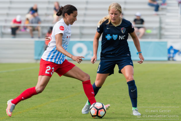 Christen Press and Makenzie Doniak battle during the Red Stars' win over the Courage. (Photo copyright Lewis Gettier)