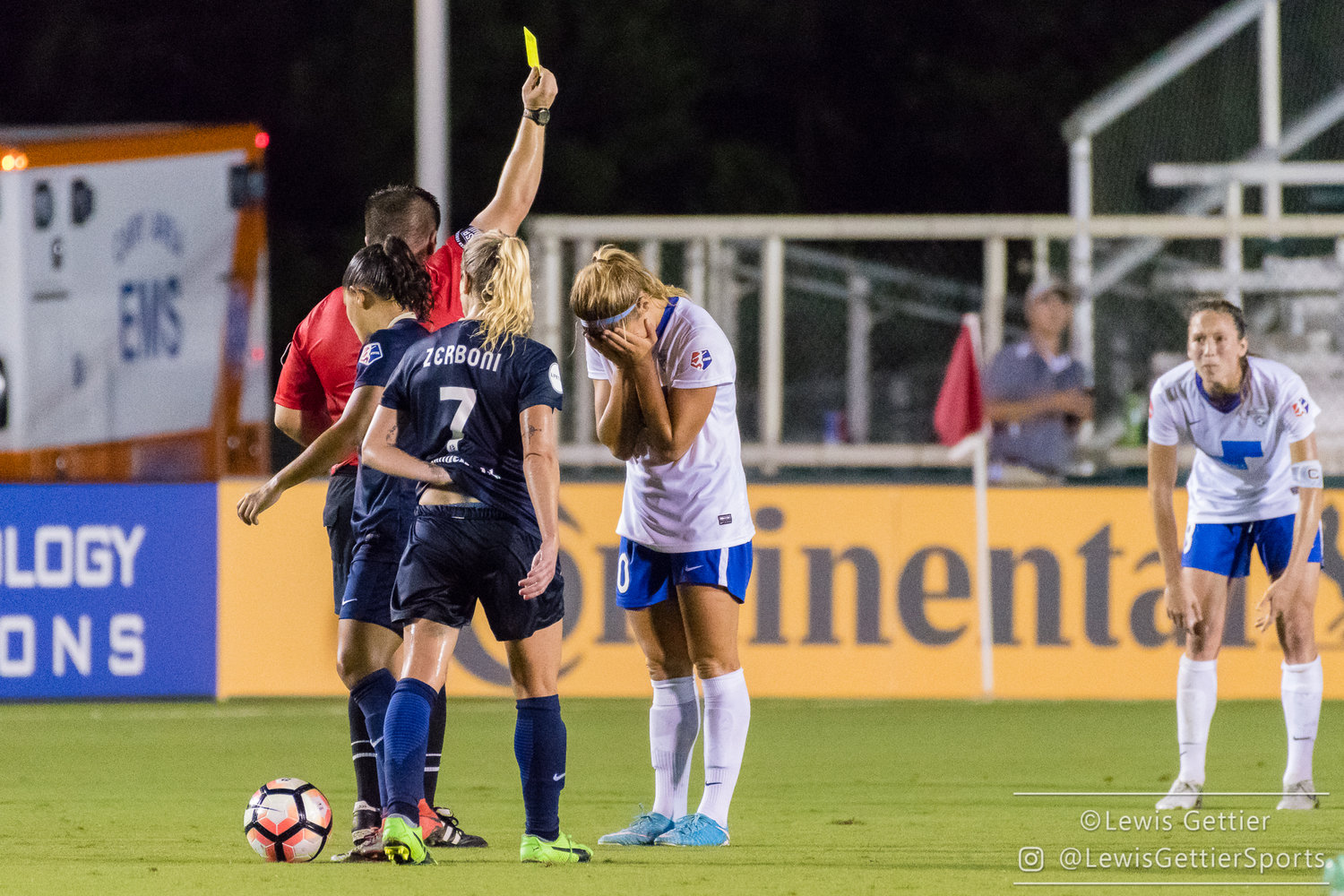 Rosie White can't look as she receives her 5th yellow card and with in an automatic, one-game suspension. )Photo by Lewis Gettier)