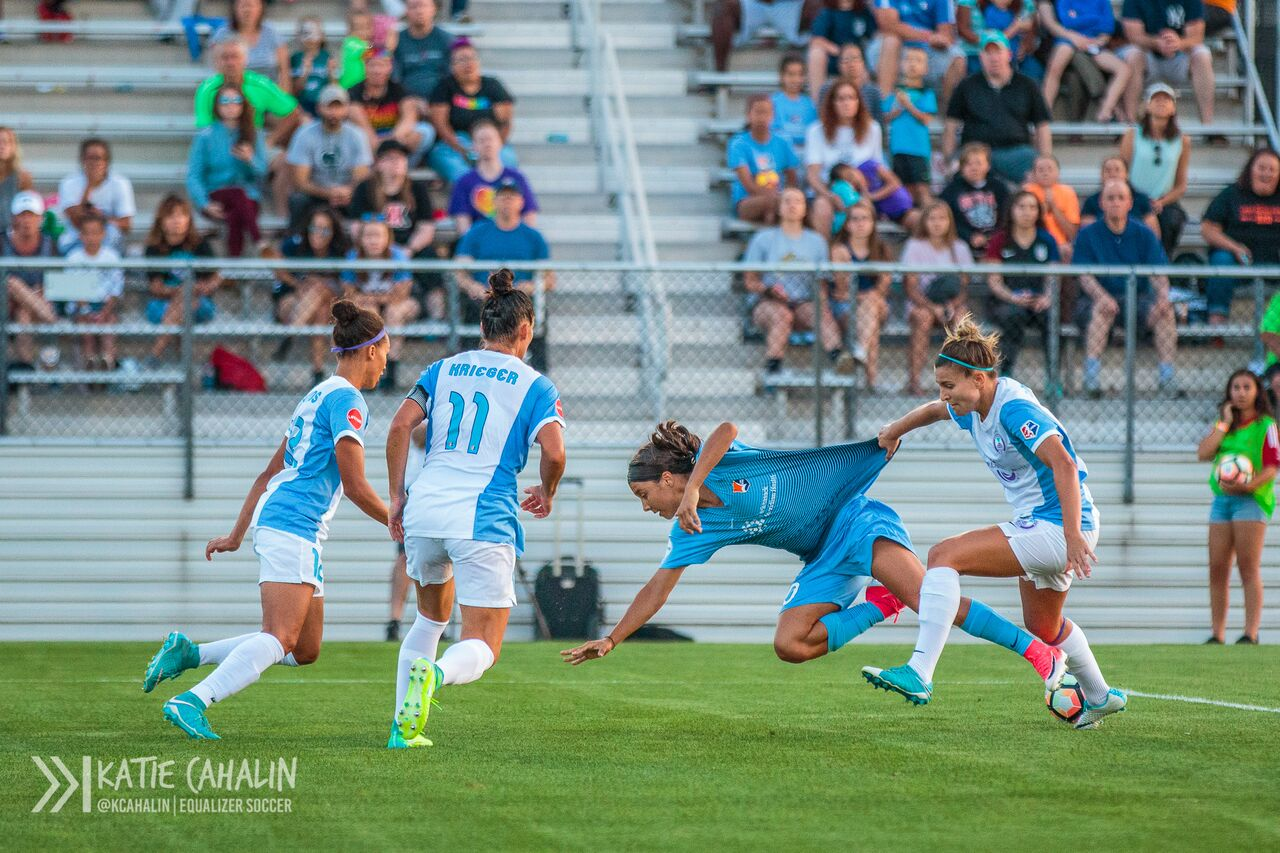 Steph Catley gets a fistful of jersey as she fouls Sam Kerr inside the box. (photo copyright Katie Cahalin for The Equalizer)