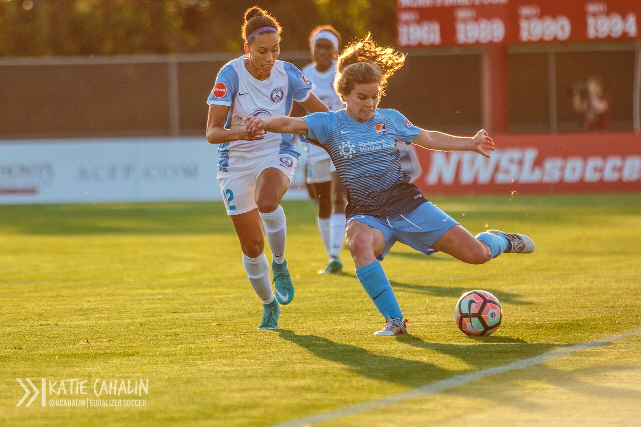 Daphne Corboz sends a ball in from the touchline as Kristen Edmonds attempts to catch up on defense. (photo copyright Katie Cahalin for The Equalizer)