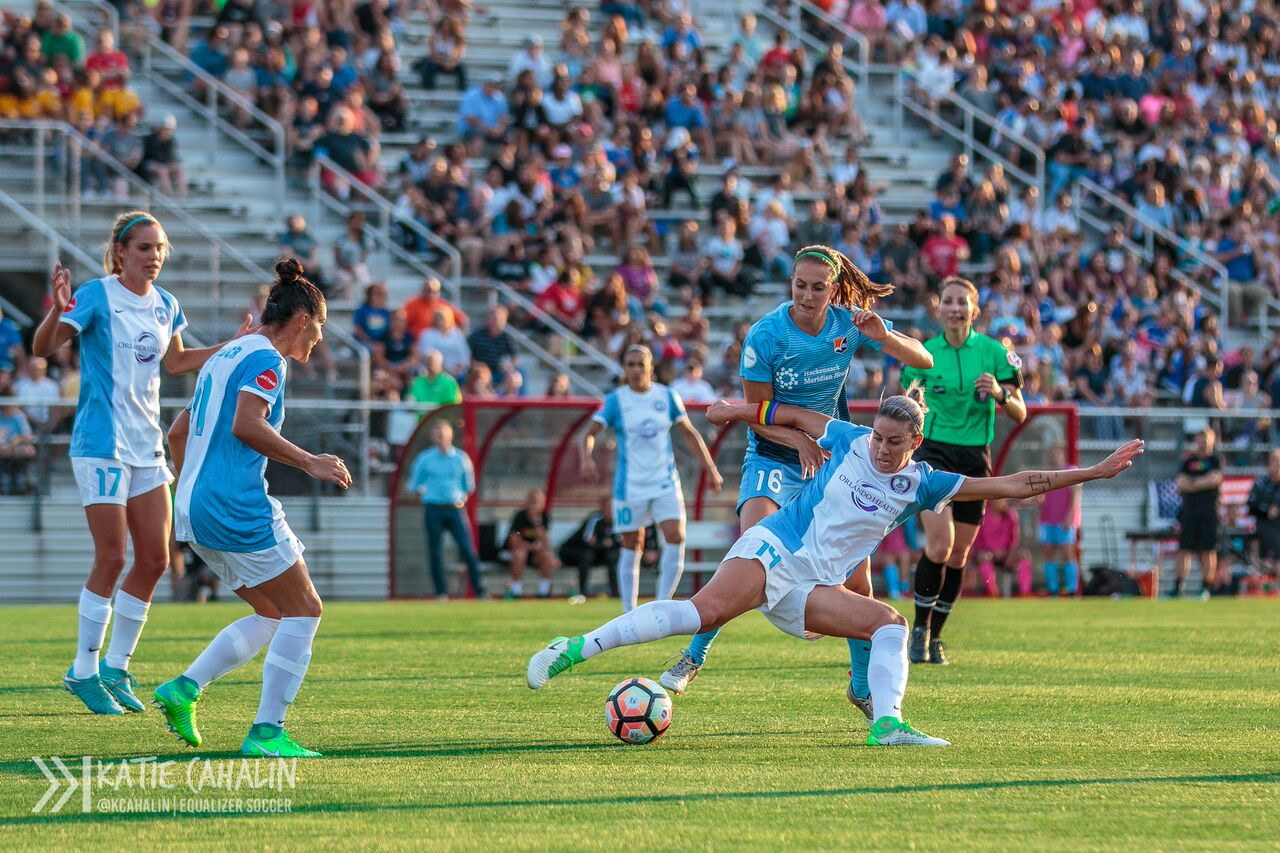 Alanna Kennedy stretches out to block Sarah Killion from the ball. (photo copyright Katie Cahalin for The Equalizer)