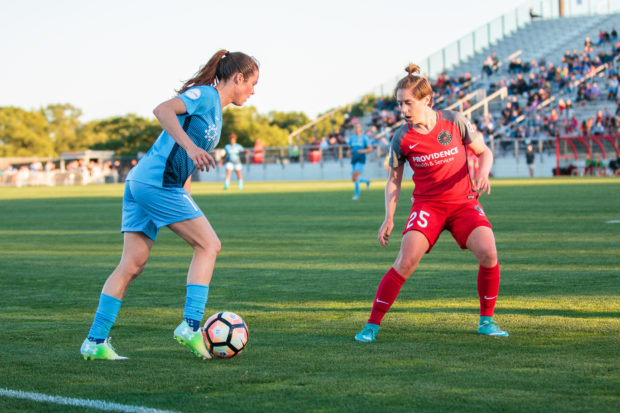 Meghan Klingenberg, red, defends Kelley O'Hara during one of their many battles Saturday night at Yurcak Field (photo copyright Katie Cahalin for The Equalizer)
