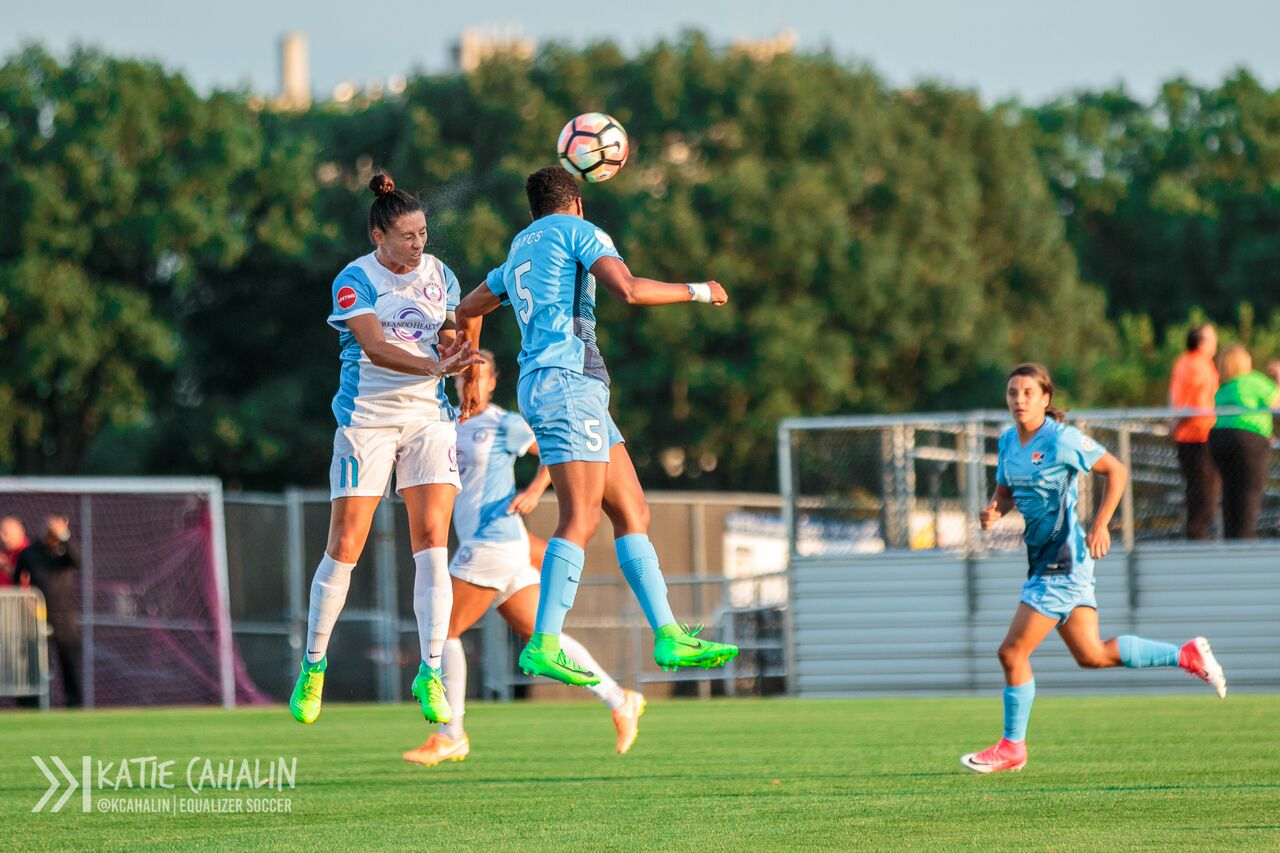 Former Nittany Lions Ali Krieger and Maya Hayes go up for a header. (photo copyright Katie Cahalin for The Equalizer)