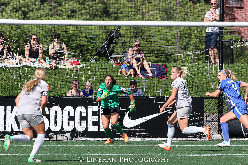 Sammy Jo Prudhomme,in green, coming out for a ball during her professional debut last weekend. (photo copyright Linehan Photography for The Equalizer)