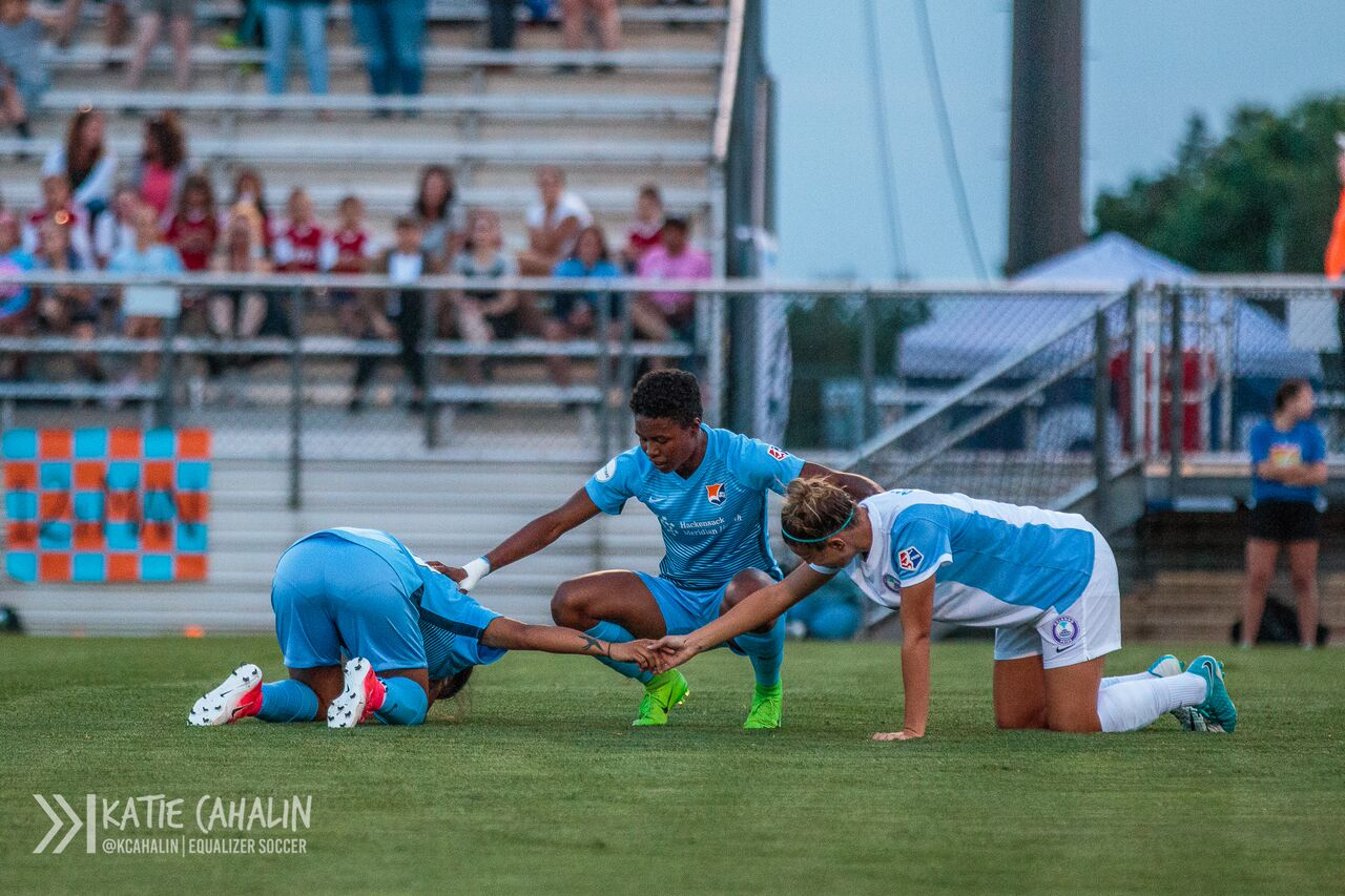 Sam Kerr and Steph Catley shake it out after a collision. (photo copyright Katie Cahalin for The Equalizer)